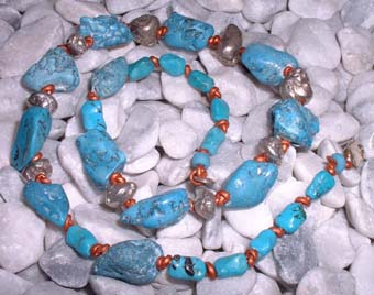 turquoise and silver beadsneklace on copper leather thong
