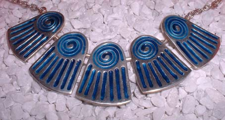 silver necklace with 5 blue enamel pieces